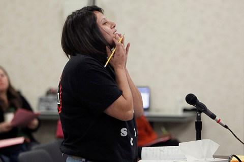Chrissy Guzman speaks in frustration during a Adelanto School District board meeting regarding the parent trigger law, in Adelanto, California