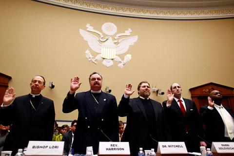 Catholic Bishop William Lori,  the Rev. Matthew Harrison, Dr. Ben Mitchell, Rabbi Meir Soloviechik and Craig Mitchell are sworn.