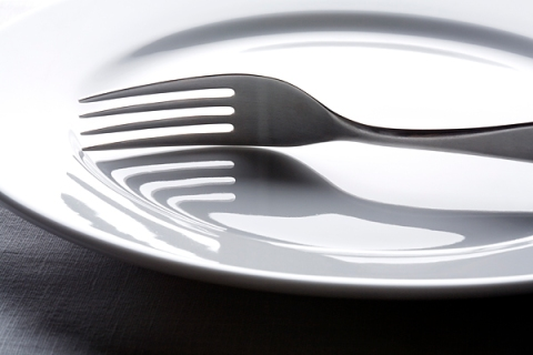 Fork on empty white plate