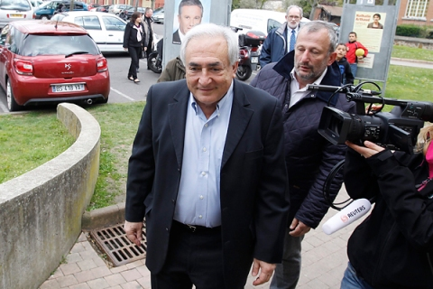 Former IMF head Strauss-Kahn leaves after he voted in the first round of the 2012 French presidential election at a polling station in Sarcelles