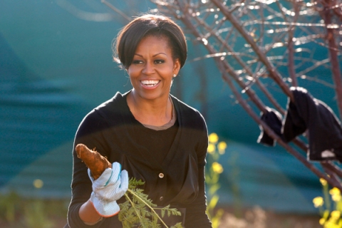 US First Lady Michelle Obama holds up a