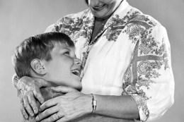 Son hugging mother