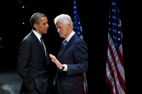President Barack Obama talks with former President Bill Clinton