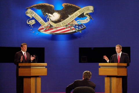 George W. Bush (R) and Al Gore debate in their first debate