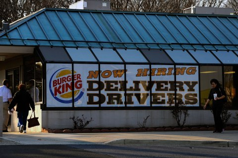 image: A Burger King in Olney, Md., advertises for delivery drivers, March 7, 2012.