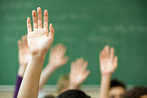 Image: Hands raised in classroom