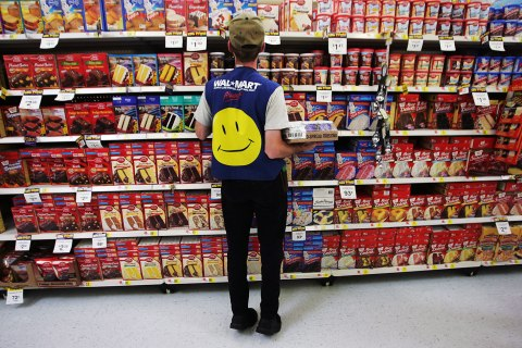 Wal-Mart Dominates U.S. Retail Economyimage: An employee restocks a shelf in the grocery section of a Wal-Mart Supercenter in Troy, Ohio, May 11, 2005.