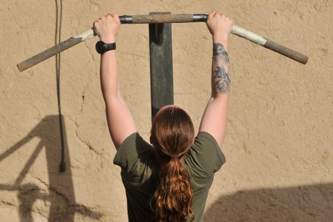 A USN Hospital Corspman assigned to the Female Engagement Team from 1st Battalion 7th Marines Regiment works out at Forward Operating Base Jackson on June 15, 2012.