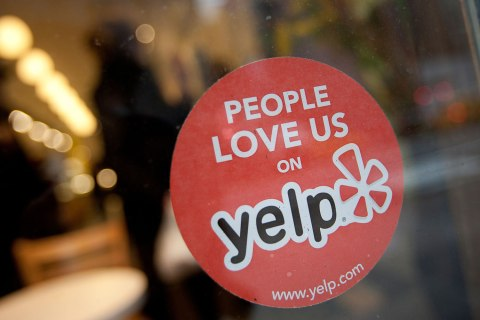 image: The Yelp Inc. logo is displayed in the window of a restaurant in New York, U.S., on March 1, 2012.