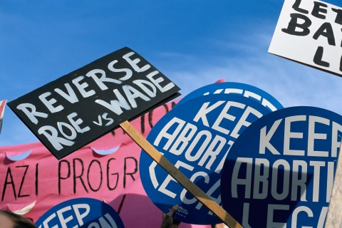 Signs For and Against Abortion Rights