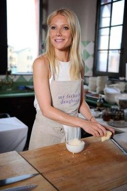 Gwyneth Paltrow prepares food in the kitchen