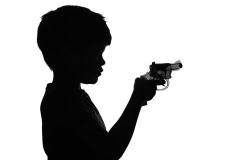 Child holding a toy gun