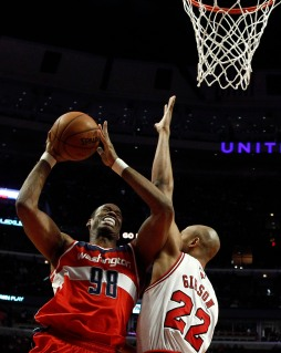 From Left: Washington Wizards' Jason Collins goes to the basket against Chicago Bulls' Taj Gibson in Chicago, on April 17, 2013.