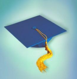 A graduation cap with tassles dangling
