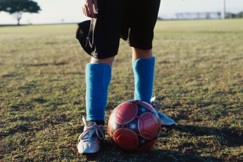 Soccer Player's Legs with soccer ball