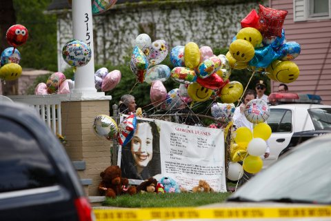 Well wishers gather at Gina DeJesus' home in Cleveland, Ohio, in anticipation of her homecoming, May 7, 2013.