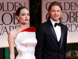 Angelina Jolie and Brad Pitt pose for photographers as they arrive at the 69th annual Golden Globe Awards in Beverly Hills, Calif., on Jan. 15, 2012.