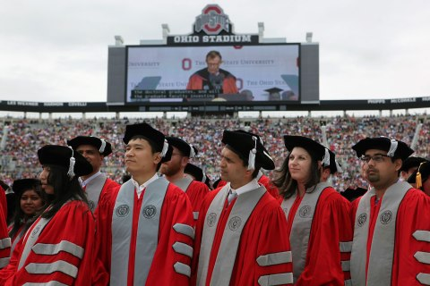 Doctorate students at Ohio State University listen as president Gordon Gee introduces them during spring commencement