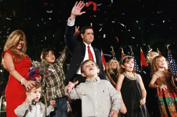 """Republican nominee for Florida U.S. Senator Marco Rubio is surrounded by his family during his """"Reclaim America Victory Celebration"""" at the Biltmore Hotel in Coral Gables, Fla., on Nov. 2, 2010."""