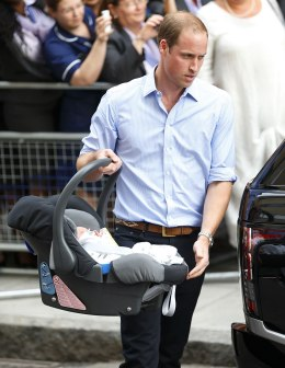 Prince William, Duke of Cambridge carries his newborn son as he and Catherine, Duchess of Cambridge leave The Lindo Wing at St Mary's Hospital in London, on July 23, 2013.