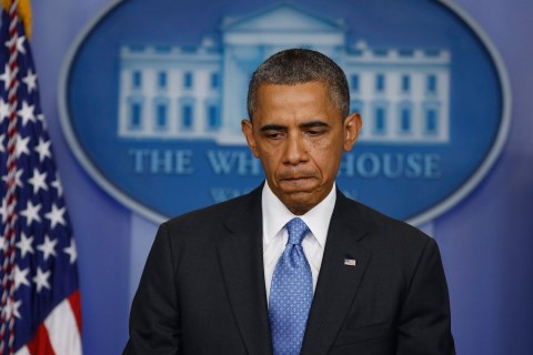 U.S. President Obama pauses as he talks about the Trayvon Martin shooting in the press briefing room at the White House in Washington