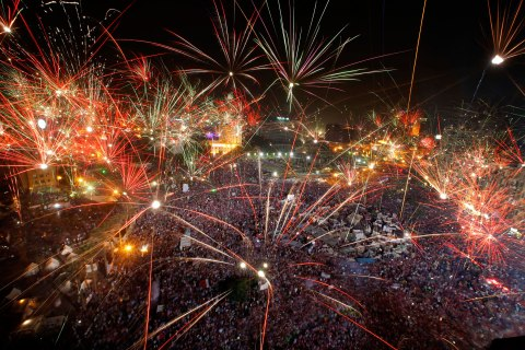 Fireworks light the sky as opponents of Egypt's Islamist President Mohammed Morsi celebrate in Tahrir Square in Cairo, Egypt, Wednesday, July 3, 2013.