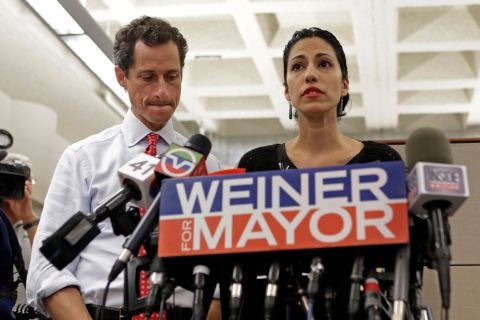 From left: New York mayoral candidate Anthony Weiner listens as his wife, Huma Abedin, speaks during a news conference at the Gay Men's Health Crisis headquarters in New York City, on July 23, 2013.