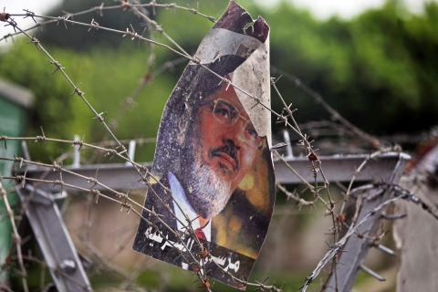 A poster of ousted President Mohammed Morsi hangs on the barb wire at the Republican Guard building in Nasr City, Cairo, on July 9, 2013.
