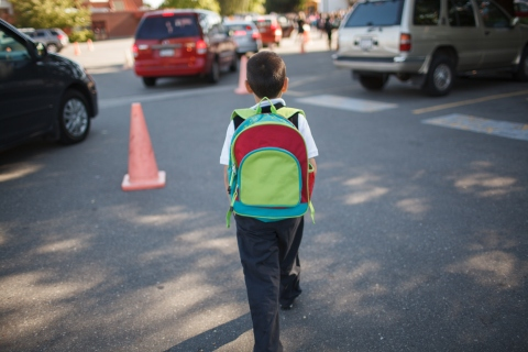 Boy with backpack walking to school