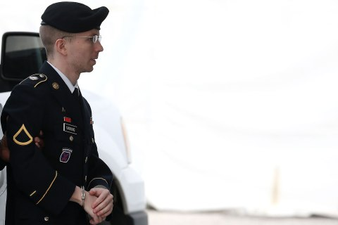 U.S. Army Private First Class Bradley Manning is escorted by military police as he arrives for his sentencing at military court facility for the sentencing phase of his trial on August 21, 2013 in Fort Meade, Md.