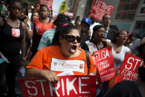 Demonstrators in support of fast food workers march towards a McDonald's as they demand higher wages and the right to form a union without retaliation in New York City, on July 29, 2013.