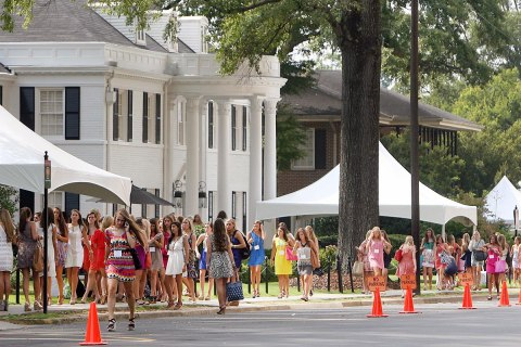 Potential new sorority members walk along sorority row during the annual Fall Formal Sorority Recruitment on the campus of the University of Alabama,  Aug. 16, 2012.