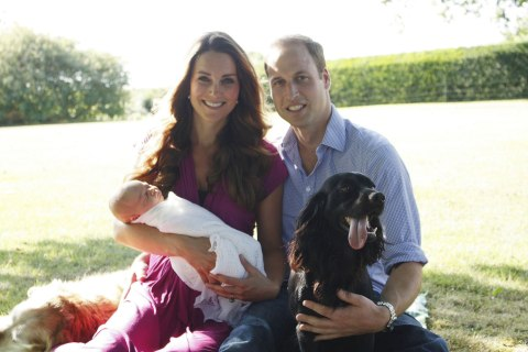 The Duke and Duchess of Cambridge with their son Prince George in the garden of the Middleton family home in Bucklebury, Berkshire surrounded by Tilly the retriever (a Middleton family pet), and Lupo, the couple's cocker spaniel, Aug. 20, 2013.