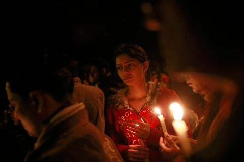 Demonstrators hold candles during a candlelight vigil for the gang rape victim who was assaulted in New Delhi, on Dec. 30, 2012.