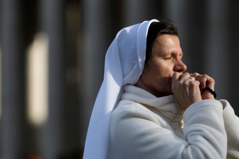 A nun prays in Saint Peter's Square