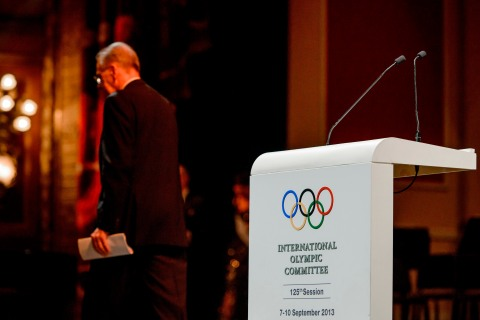 International Olympic Committee President Jacques Rogge leaves the stage after giving an inaugural speech at the opening ceremony of the 125th IOC Session at the Teatro Colon opera house in Buenos Aires, on Sept. 6, 2013.