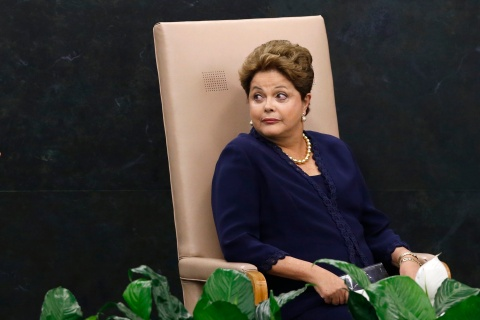 Brazil's President Dilma Rousseff reacts to someone as she waits to address the 68th United Nations General Assembly at U.N. headquarters in New York