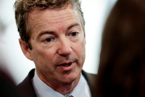 U.S. Senator Rand Paul talks with reporters as Senate Republicans and Democrats head to their weekly policy luncheon on March 19, 2013 in Washington, D.C.