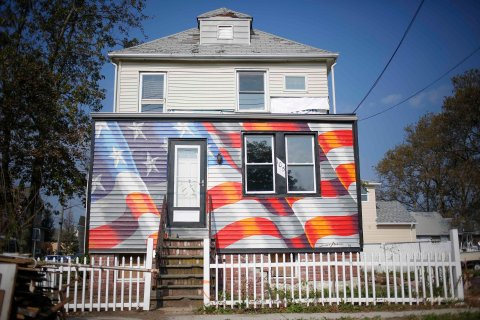 A home that was damaged by Hurricane Sandy that has been painted with an American flag in Staten Island, N.Y., on Oct. 4, 2013.