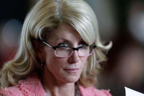 Senator Wendy Davis listens as the Texas Senate debate an abortion bill before the final vote, on July 12, 2013, in Austin.