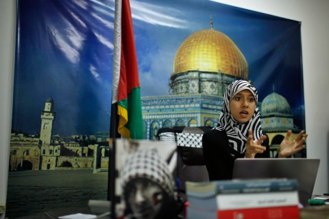 Isra Al-Modallal, a spokeswoman of the Hamas government in Gaza, talks to the foreign media at her office in Gaza City, on Nov. 11, 2013.
