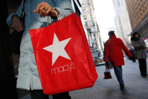 A woman holds a Macy's Inc shopping bag outside a store in New York City, on  Jan. 7, 2010.