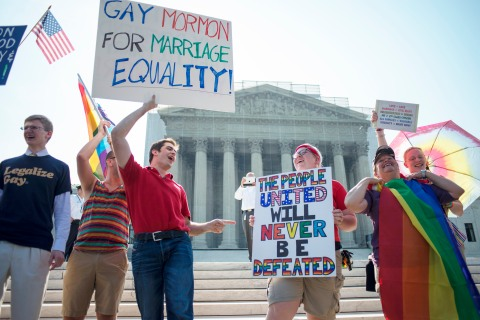 Gay rights supporters cheer and chant outside of the United States Supreme Court waiting for the ruling  on Proposition 8 and the Defense of Marriage Act in Washington, D.C. on June 26, 2013.