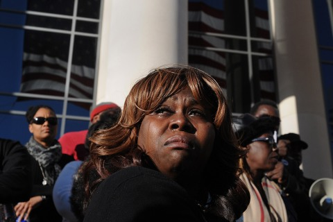 Denise Hunt tears up as she finds out the jury is deadlocked on the first-degree murder charge for Michael Dunn outside of the Duval County Courthouse as the jury enters the fourth day of deliberations