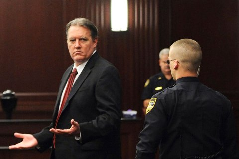 Michael Dunn raises his hands in disbelief as he looks toward his parents after the verdicts were announced in his trial in Jacksonville