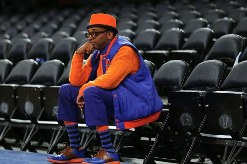 Director Spike Lee sits in his seat prior to a New York Knicks game at Madison Square Garden in New York City, April 20, 2013.