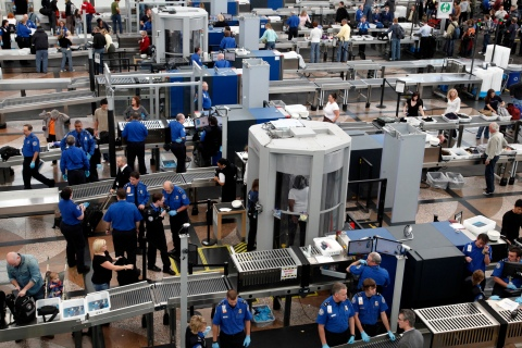Transportation Security Agency (TSA) workers carry out security checks at Denver International Airport.
